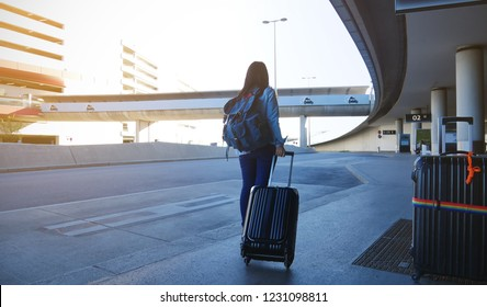 Tourist of young woman and suitcase in the airport departure lounge, which a travel concept,Holiday vacation concept, traveler suitcases in airport terminal