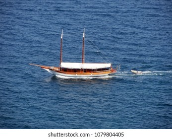 Touristic boat on the blue waters of the Bay of All Saints in Bahia, Brazil.