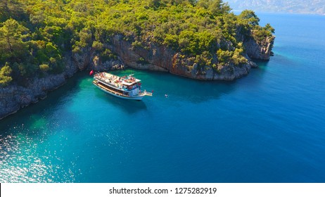 Touristic boat trips in the Gokova Bay which is located in Aegean Sea side of Turkey, turquoise sea and aerial view from the top in Marmaris/Mugla