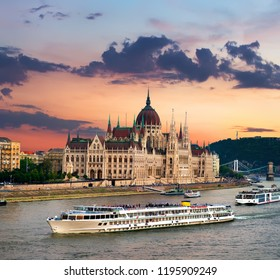 Touristic boats and Hungarian Parliament at sunset, Budapest