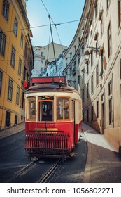 Touristic electric tram in a street of downtown Lisbon, Portugal