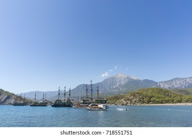 Touristic Galleons And Tour Boats Docked At Phaselis Beach, Antalya, Turkey