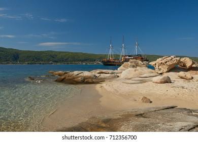 A touristic pirate ship at the blue lagoon. Greece. Halkidiki