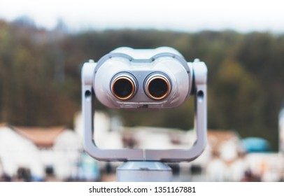 touristic telescope look at the city with view snow mountains, closeup metal binocular on background viewpoint observe vision, coin operated in panorama observation, travel nature concept