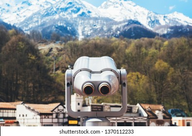 touristic telescope look at the city with view snow mountains, metal binocular on background viewpoint observe vision, closeup coin operated in panorama observation, travel nature concept