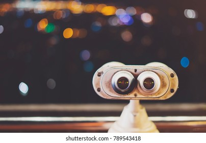 Touristic telescope look at city with view of Barcelona Spain, close up old metal binoculars on background viewpoint, hipster coin operated in panorama observation, mockup flare, illumination bokeh