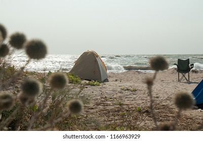 Touristic tent on beah at Azov sea, Ukraine. Stormy cloudy weather.