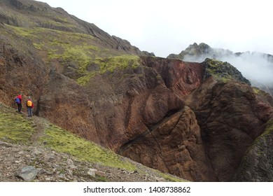 Tourists admiring amazing colorful volcanic rocks in National Park Skaftafell in South Iceland