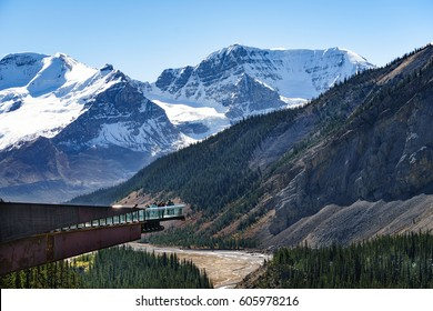 Tourists admiring the glacier valley on the glacier skywalk near the Columbia Icefield in Jasper National Park, Alberta, Canada