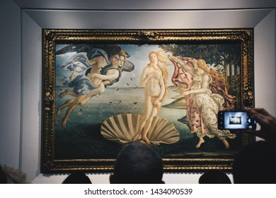 Tourists admiring a painting The Birth of Venus by the Italian artist Sandro Botticelli at the Uffizi Gallery in Florence Italy in October of 2018