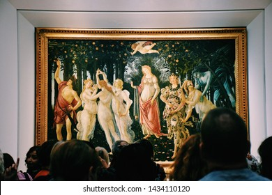 Tourists admiring a painting Primavera by the Italian Renaissance painter Sandro Botticelli at the Uffizi Gallery in Florence Italy in October of 2018