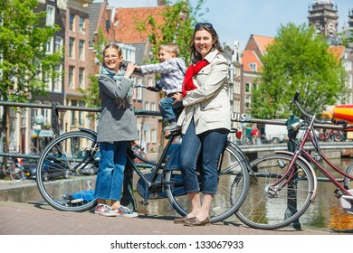 Tourists in Amsterdam. Mother with her kids walking in the streets of Amsterdam. The Netherlands