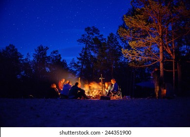 Tourists around the campfire at night. Olkhon Island Lake Baikal.