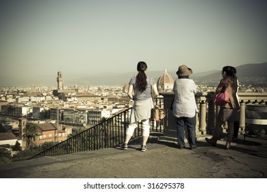 Tourists from Asia look the panorama of the city of Florence