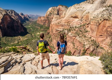 Tourists with backpack hiking in Zion National Park, Utah, USA