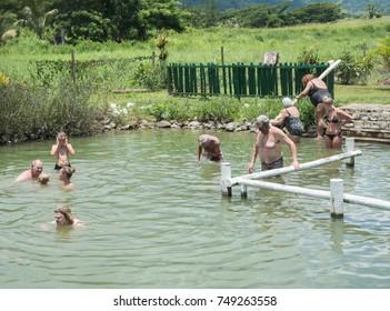 Tourists bathing in natural hot spring in remote Nadi, Fiji/Hot Spring Experience/NADI,FIJI,PACIFIC ISLANDS-NOVEMBER 27TH,2016: Tourists and natural hot spring in Sabeto River Valley in Nadi, Fiji