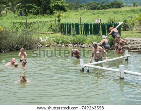 433189b1ddfbdf Tourists bathing in natural hot spring in remote Nadi, Fiji/Hot Spring  Experience/