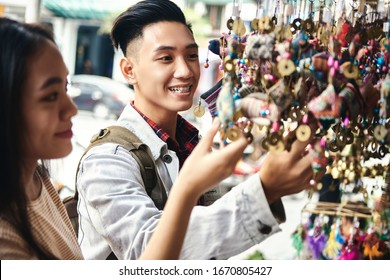 Tourists buying decorations at the Vietnamese market