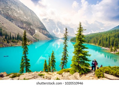 Tourists by Moraine Lake, Banff National Park, Alberta, Canada