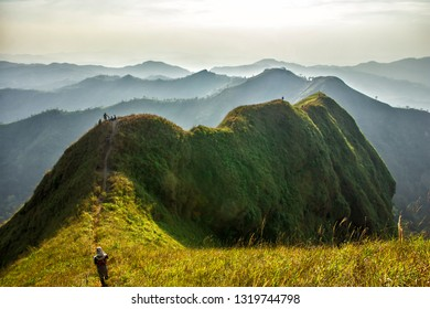 Tourists climbing the mountain to see the beautiful of nature at Khao Chang Puak Mountain in Thong Pha Phum National Park, Kanchanaburi, Thailand.