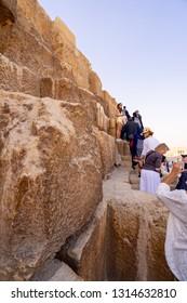 Tourists climbing  Pyramid of Giza near Cairo. Captured in Egypt. Autumn 2018