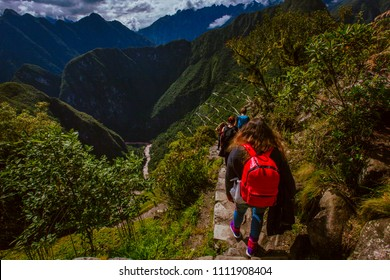 Tourists come down from the Huaynapicchu mountain. You can see the Urumbamba river and the road to Machupicchu.