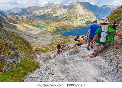 Tourists coming down from the Szpiglasowa Pass, Tatry mountains, Poland