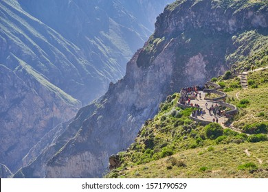 Tourists at the Cruz del Cóndor viewpoint, Colca Canyon, one of the deepest in the world, Peru