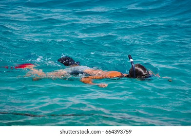 Tourists doing snorkeling in the Red sea. Marsa Alam Egypt.