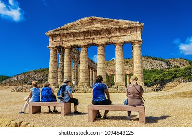 Tourists at Doric temple in Segesta on Sicily, Italy