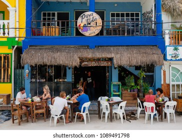 Tourists eating at a restaurant in the town of Isla Holbox, Mexico on Thursday, May 10, 2018.