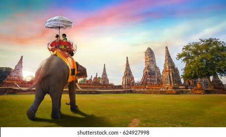 Tourists With an Elephant at Wat Chaiwatthanaram temple in Ayutthaya Historical Park, a UNESCO world heritage site in Thailand