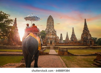 Tourists With an Elephant at Wat Chaiwatthanaram temple in Ayuthaya Historical Park, a UNESCO world heritage site in Thailand