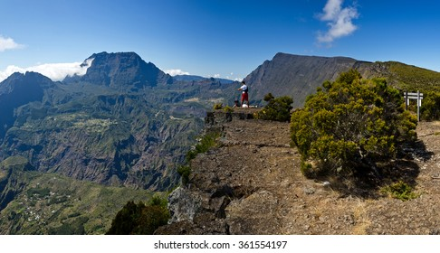 Tourists enjoy a beautiful view into the interior of Reunion Island in the Cirque de Mafate