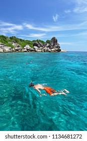 Tourists enjoy the beauty of underwater at Similan Islands #8 (sailing rocks) on Similan Islands Marine National Park Phang Nga Province, Southern Thailand
