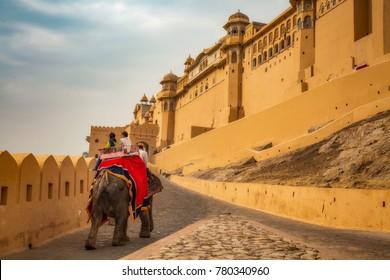 Tourists enjoy elephant ride at Amber Fort Jaipur Rajasthan