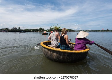 Tourists  enjoy rowing  basket boat . It is a unique Vietnamese travel at Cam thanh village.Hoian, Danang, Vietnam ,18 Oct. 2018.