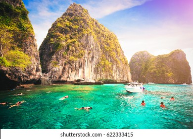 Tourists enjoy with snorkeling in a tropical sea at Maya bay Phi Phi Islands Andaman in Krabi, Thailand