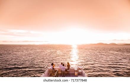 Tourists enjoy sunset cruise in phuket