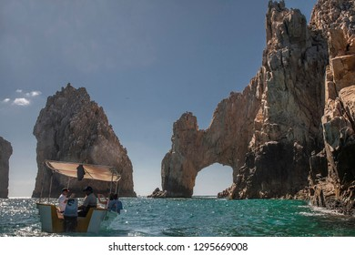 Tourists enjoy the views on a boat at Land's End near Cabo San Lucas at Baja California, Mexico