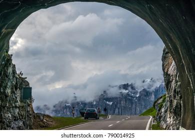 Tourists enjoying the scenery at Susten Pass, Switzerland just outside a tunnel.