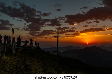 Tourists enjoying the sunrise on Mount Rigi, Switzerland, 01.08.2017