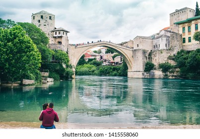Tourists enjoying the view of old brigde in Mostar Bosnia and Herzegovina