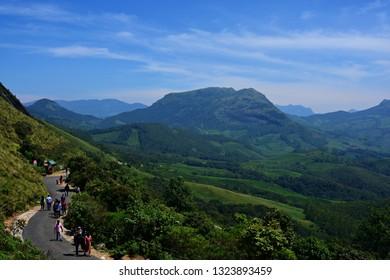 """Tourists exploring the valleys of Eravikulam National Park, Munnar, Kerala, South India on 24th October 2018"""