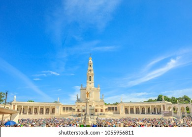Tourists, faithful and pilgrims in the square of the Sanctuary of Fatima in Portugal for the 100th anniversary of the apparitions of the Virgin Mary. Copy space.