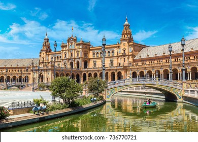 Tourists float on a boat on the canal Spanish Square (Plaza de Espana), Spain
