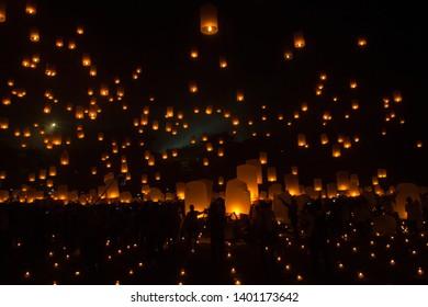 Tourists fly lanterns during Vesak at Borobudur temple, Indonesia