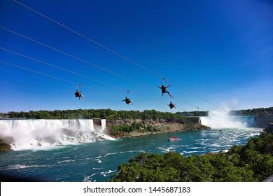 Tourists flying on zipline over Niagara Falls