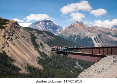 Tourists at the Glacier Skywalk during summer in Jasper National Park, Canadian Rockies, Alberta, Canada.