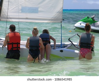 Tourists going to ride a boat.